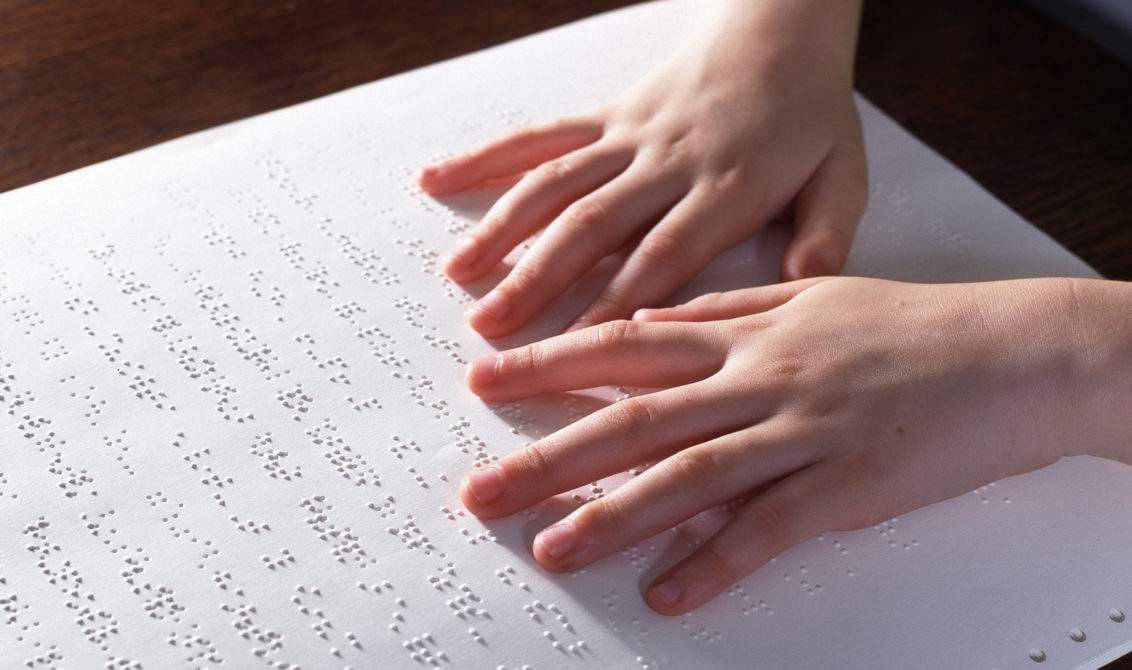Blind child reading Braille